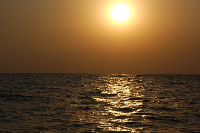 The sun setting over the three mile buoy off the coast of Gaza.